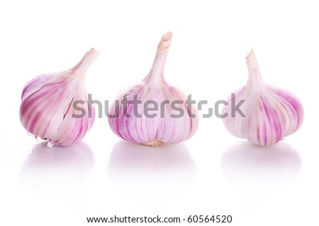 Three vitamin conceptual bulbs of garlic with reflection isolated on a white background - stock photo