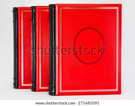 Three-volume red books isolated on white background - stock photo