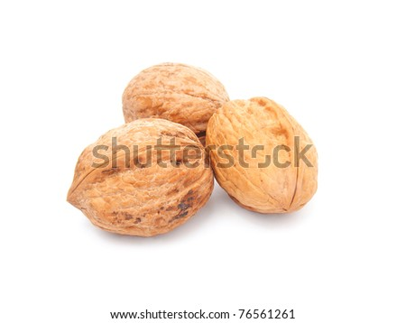 Three walnuts isolated on white