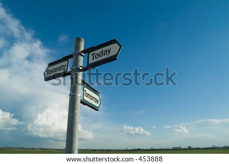 Three-way sign pointing to yesterday, today and tomorrow - stock photo