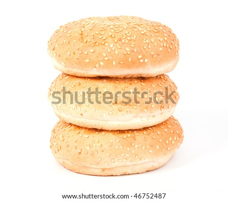 Three white bread roll with sesame over white