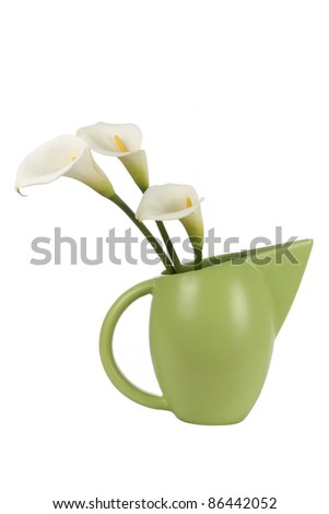 Three white Calla lilies in green vase - stock photo