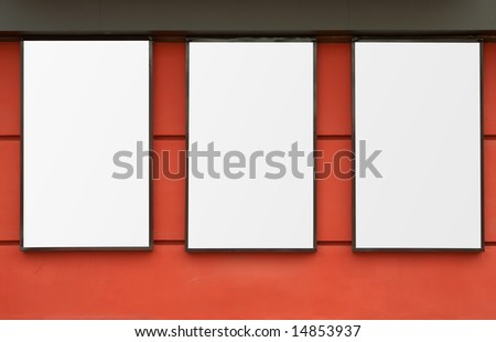 three white frames on red wall - stock photo