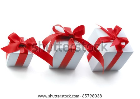 Three white gift box with red ribbon