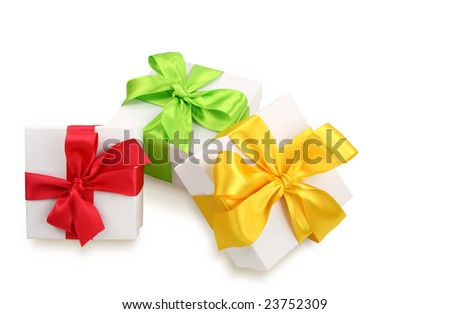 Three white gift boxes with colorful ribbons isolated on white background