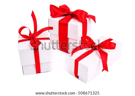 three white gift boxes with red ribbon on white background