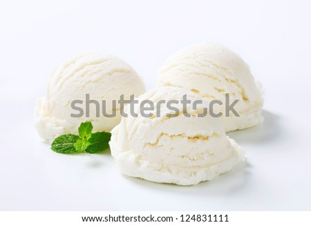 Three white ice cream scoops