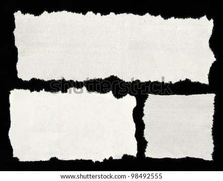 Three white newspaper clippings on black background. Copy space for advertising - stock photo
