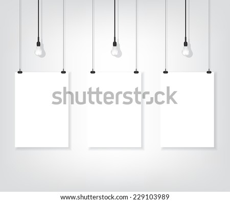 Three white poster on wall and bulb - stock photo