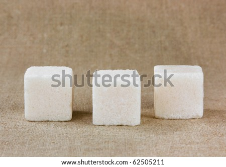 Three white sugar cubes - stock photo