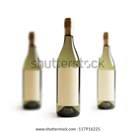 Three white wine bottle, with real paper blank label. Label is at eye level so inserted elemets do not need to be curved (wrapped around) so much. Focus on center label. Isolated on white. - stock photo
