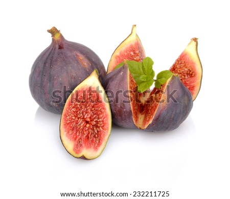 Three whole figs look like flower with spearmint, isolated on white background - stock photo