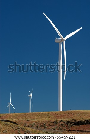 Three windmills in an electric wind farm in the desert of eastern Oregon - stock photo