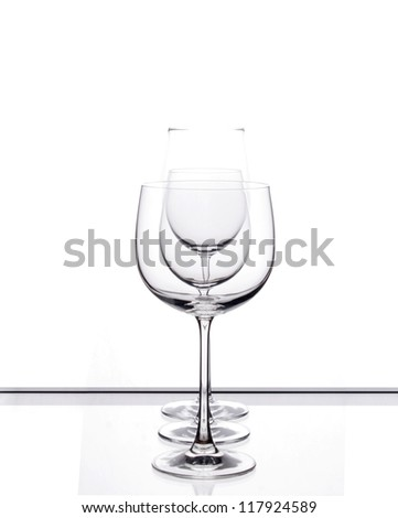 Three wine glasses arranged in a row. - stock photo
