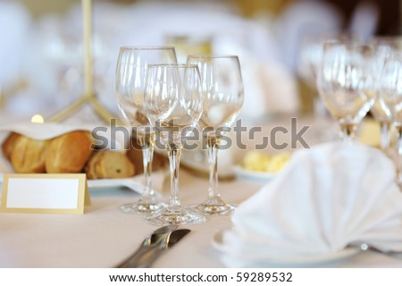Three wine glasses on a white festive table - stock photo