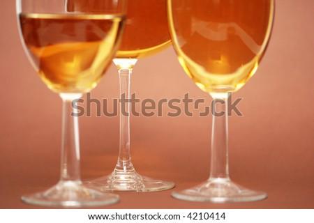 Three wine glasses on the biege  background - stock photo