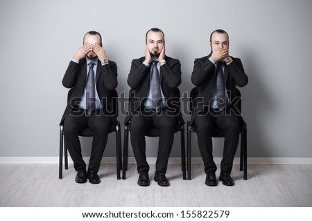 three wise businessman that they didn't hear, speak and see. - stock photo