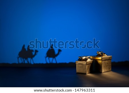Three wise men on the way to Jesus in Bethlehem and presents - stock photo