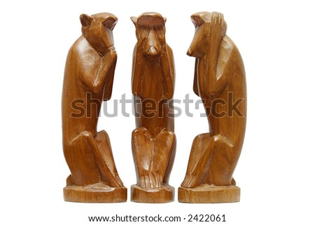 Three wise monkeys.  See no evil, hear no evil and speak no evil. - stock photo