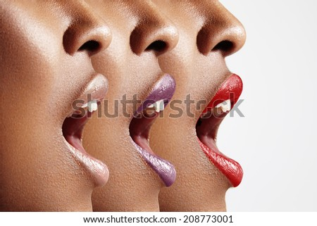 three woman's profiles with different lip color - stock photo
