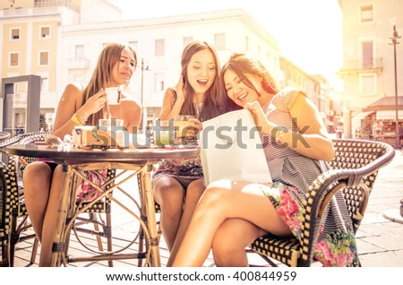Three woman talking and having fun about the shopping they did. Concept about consumerism - stock photo