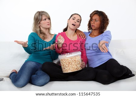 Three woman watching a movie. - stock photo
