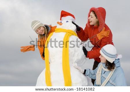 Three women having fun at winter - stock photo