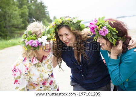 Three women laughing together, Nykoping, Sodermanland, Sweden - stock photo