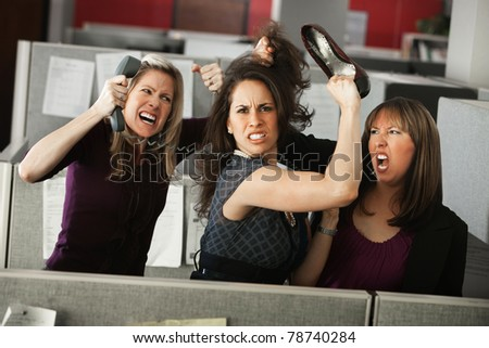 Three women office workers quarreling in cubicle - stock photo