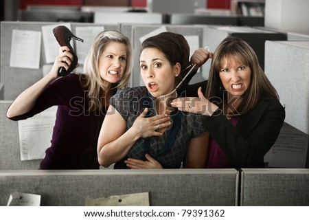 Three women office workers quarrels in cubicle - stock photo