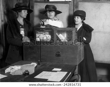 Three women's suffragists casting votes in New York City, ca. 1917