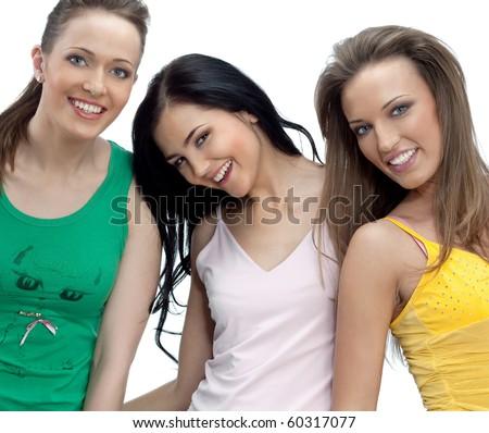 Three women smiling on white background - stock photo