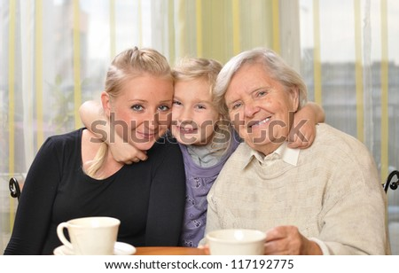 Three women - three generations. Happy and smiling family. MANY OTHER PHOTOS WITH THIS FAMILY IN MY PORTFOLIO. - stock photo