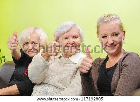Three women - three generations. Happy and smiling family. MANY OTHER PHOTOS WITH THIS FAMILY IN MY PORTFOLIO.