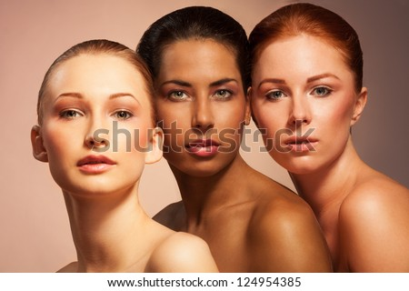 Three women with different appearance in a together beauty portrait face to face - stock photo