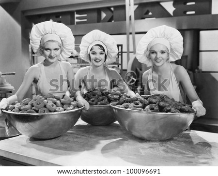 Three women with huge bowls of donuts