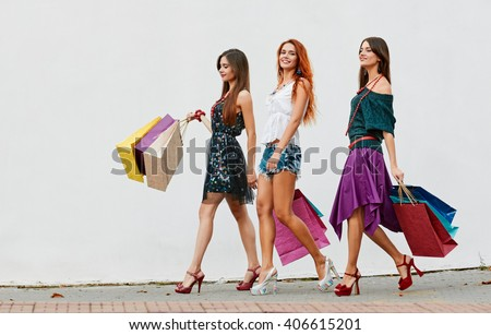 three Women with Shopping Bags - stock photo