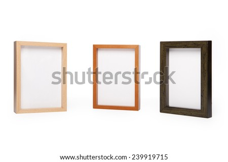 Three wood photo(picture) frames isolated white at the studio.