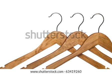 three wooden coat hanger isolated on white (focus on middle hanger) - stock photo
