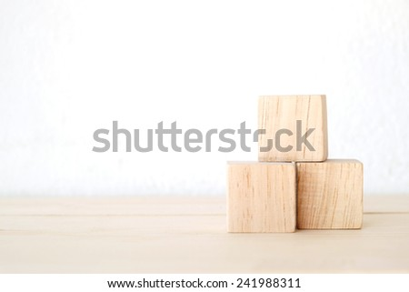 Three Wooden Cubes On Table Background