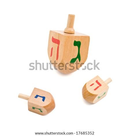three wooden dreidel Jewish Hanukkah game isolated on white - stock photo