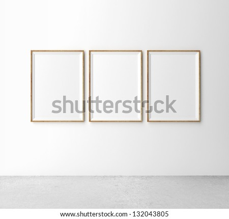 three wooden frames on wall - stock photo