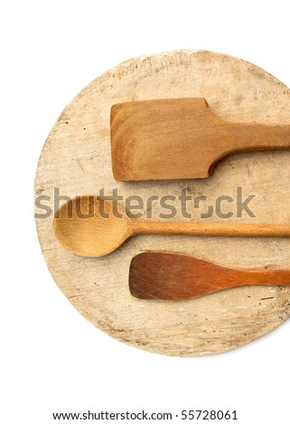 Three wooden ladles wooden on round board - stock photo