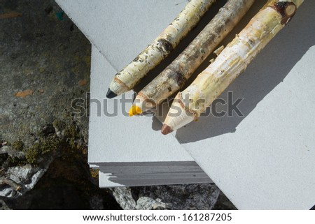 three wooden pencil on nature - stock photo