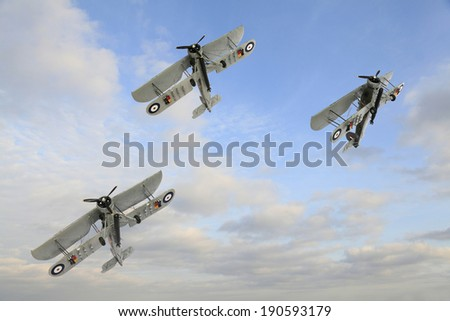 Three World War One Armstrong Whitworth FK.8 Biplanes Doing Acrobatic in Formation - stock photo