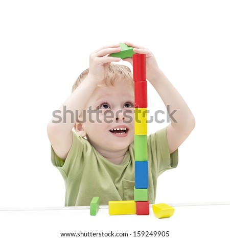 three-year child plays with toy blocks  - stock photo
