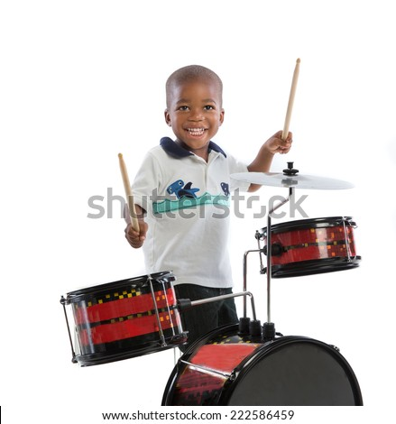 Three Year Old African American Boy Playing Drum Set Isolated on White Background