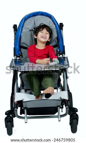 Three year old biracial disabled boy in medical stroller, happy and smiling - stock photo