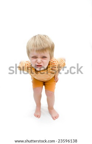 three year old boy with a naughty expression on his face. Intentional drop shadow  at feet. - stock photo