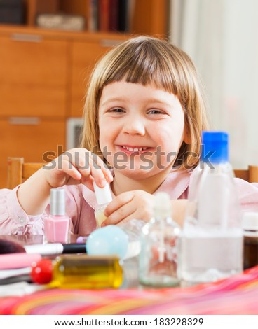 three year old child  painted cosmetics - stock photo